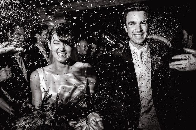 bride and groom walking through confetti at cripps stone barn