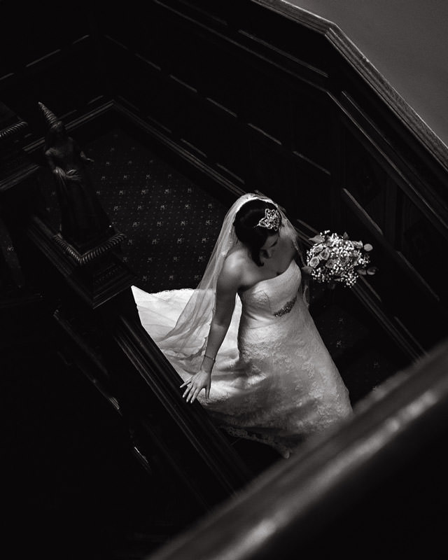 staircase wedding photograph at manor by the lake in cheltenham