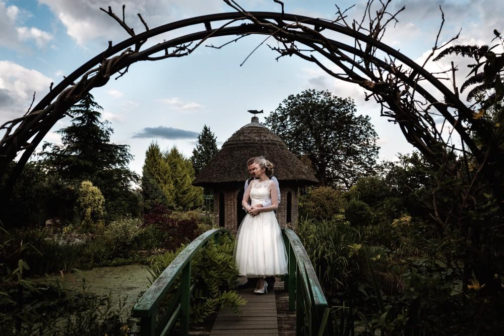 brockworth wedding bride and groom on bridge at sunset