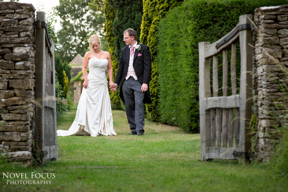 bride and groom walking together on wedding day photographer