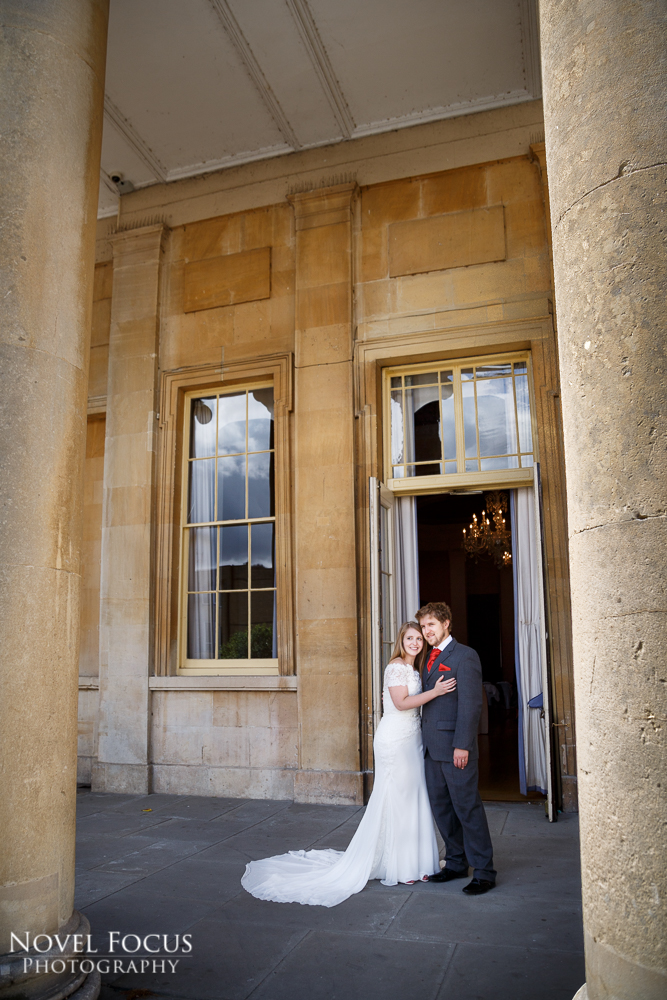 bride and groom outside pittville pump room on wedding day cheltenham