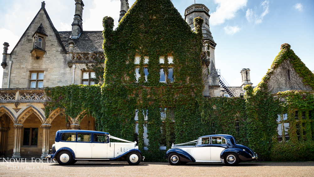 wedding cars outside manor by the lake