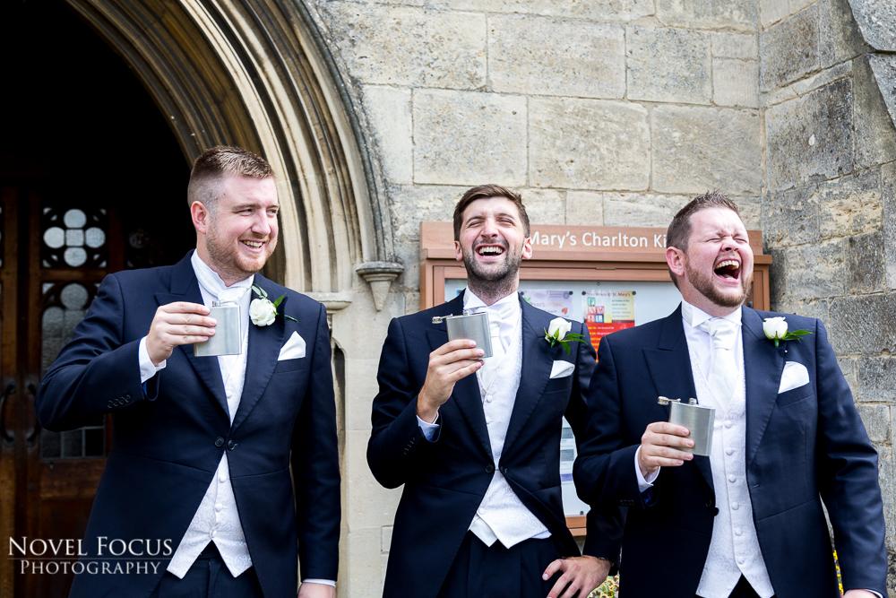 groomsmen laughing outside church