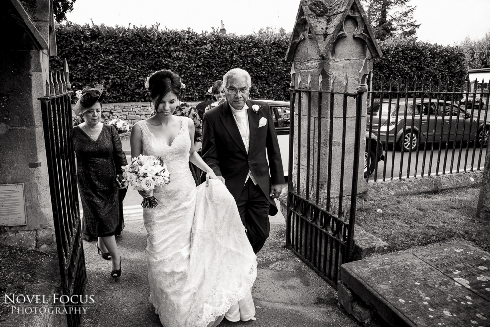 bride with father walking to wedding ceremony