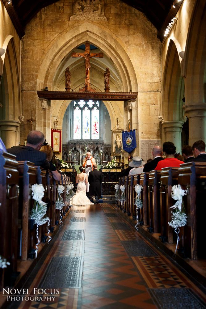bride and groom kneeling in ceremony