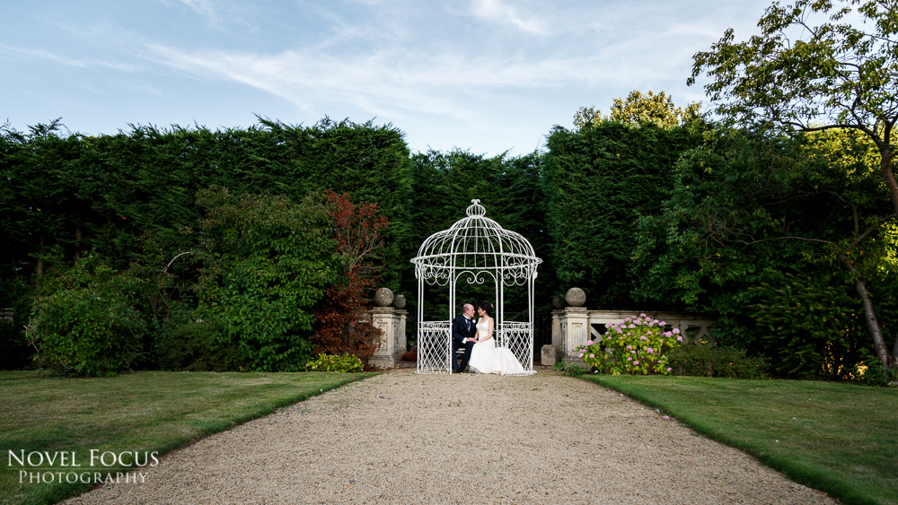 bride and groom at manor by the lake
