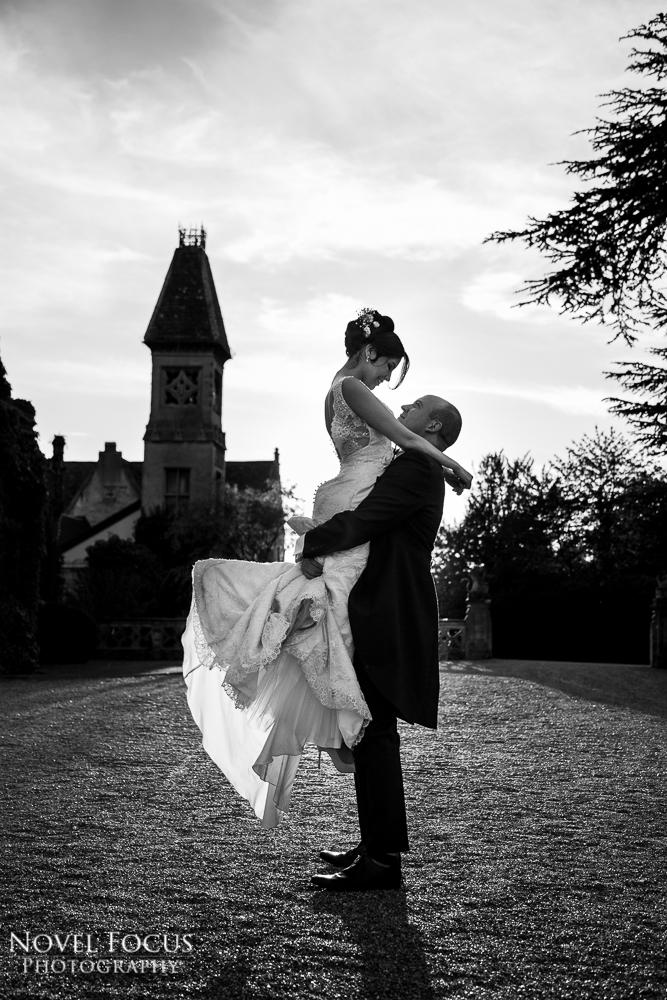 groom lifting bride up on wedding day
