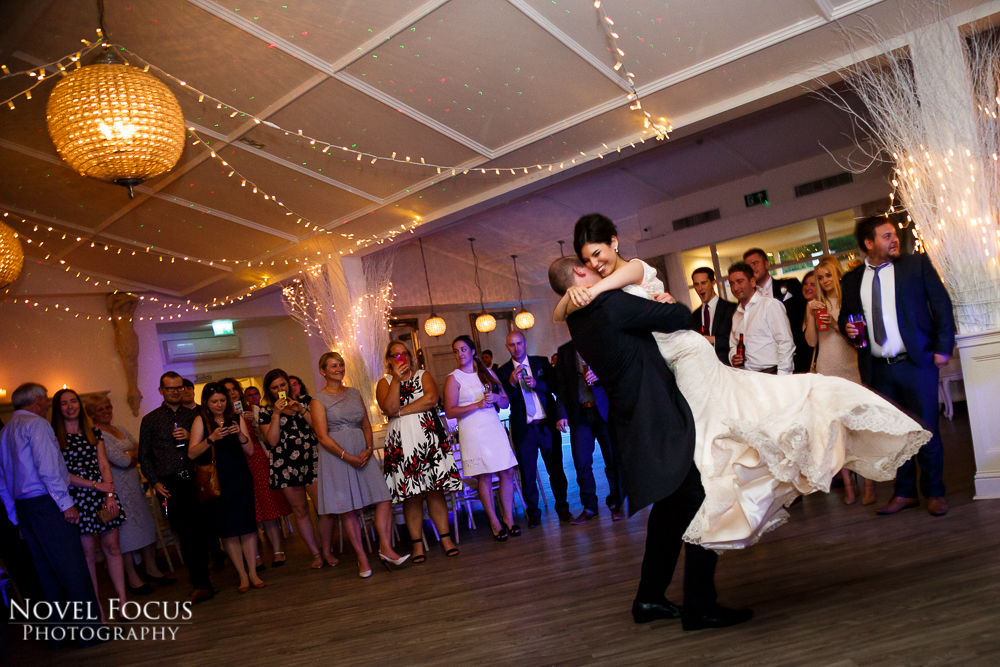 groom lifting bride in first dance wedding photography
