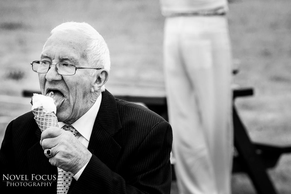 man eating ice cream at wedding reception swindon