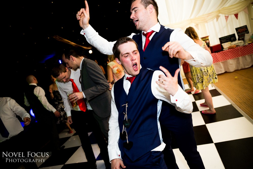 groomsmen dancing at wedding reception