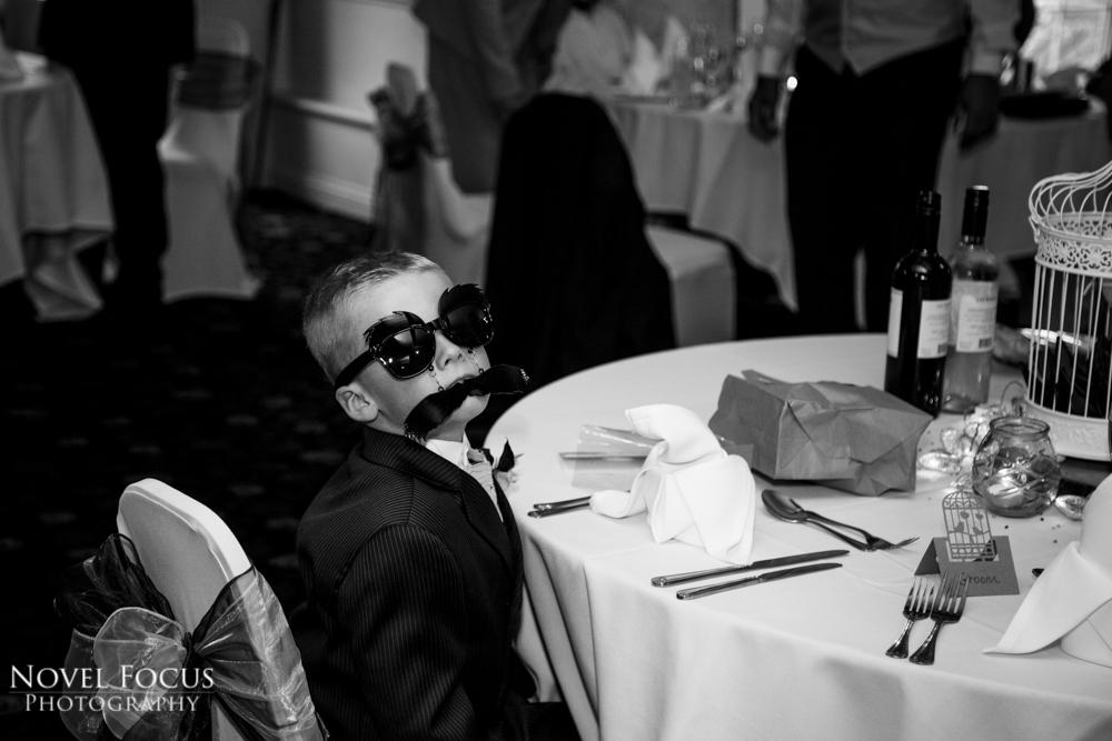 boy wearing sunglasses at wedding reception