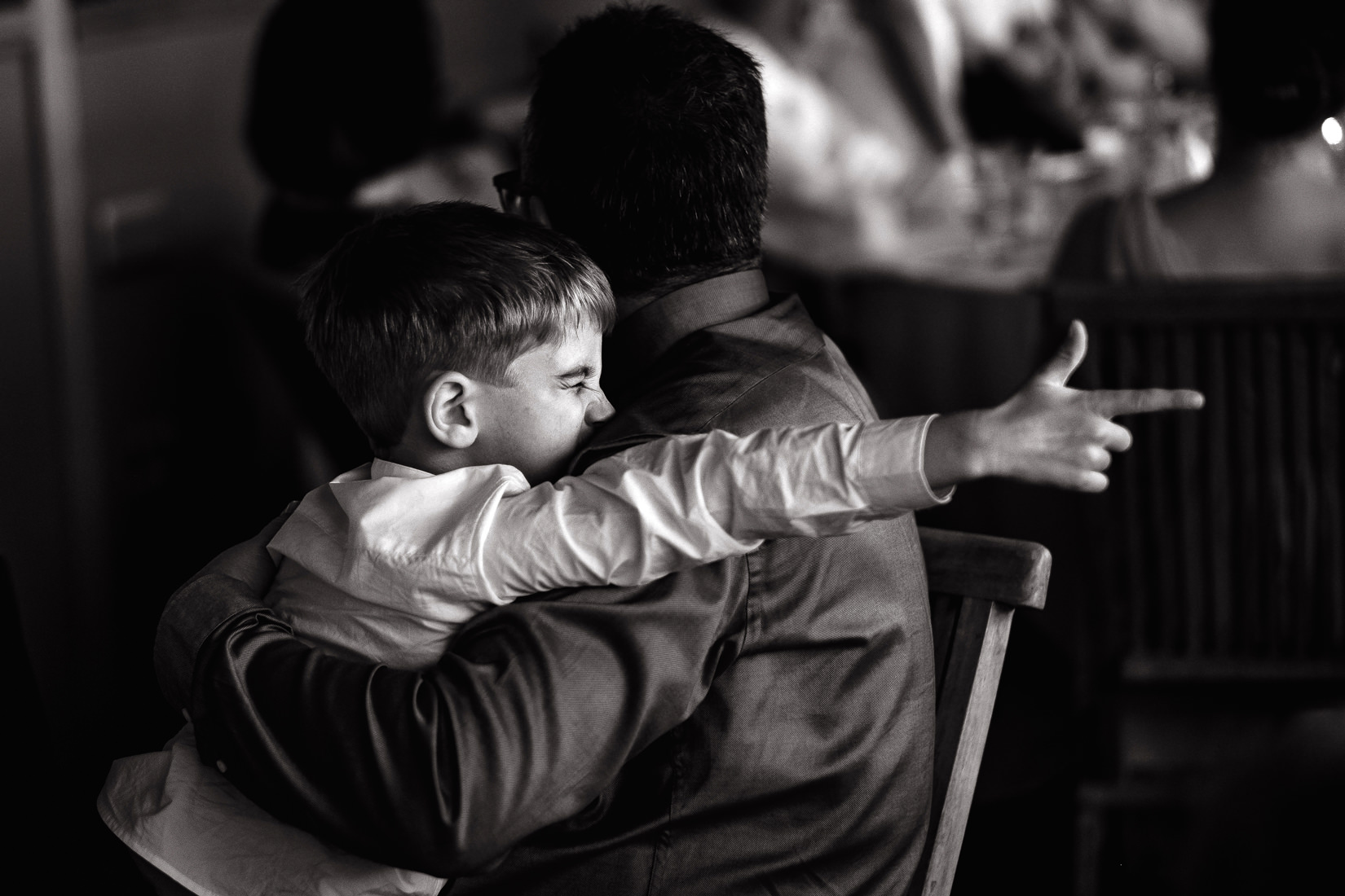 boy pointing finger at wedding reception