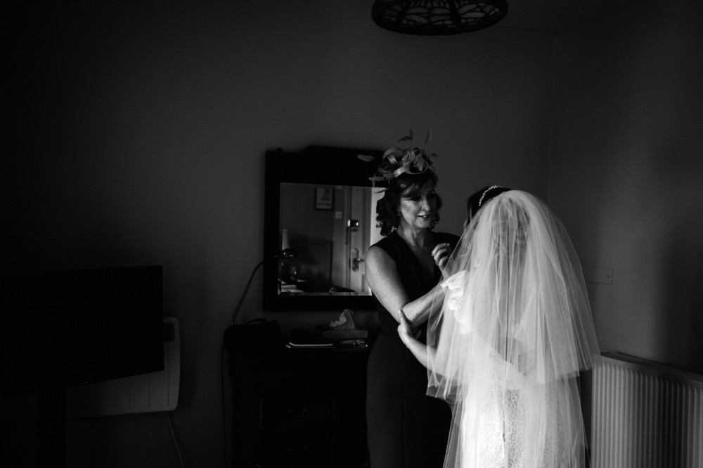reportage photograph of bride and mother in black and white taken in bath