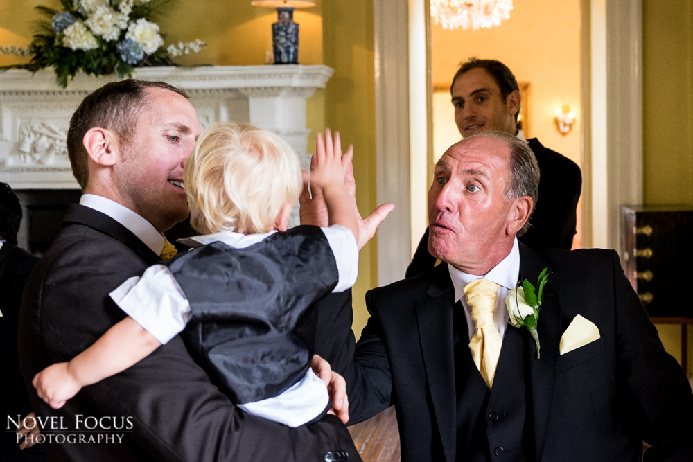 man high fiving child at wedding reception