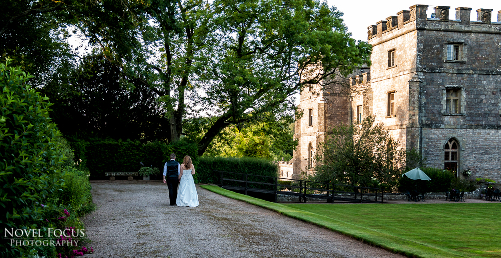 wedding photography of bride and groom walking towards clearwell castle