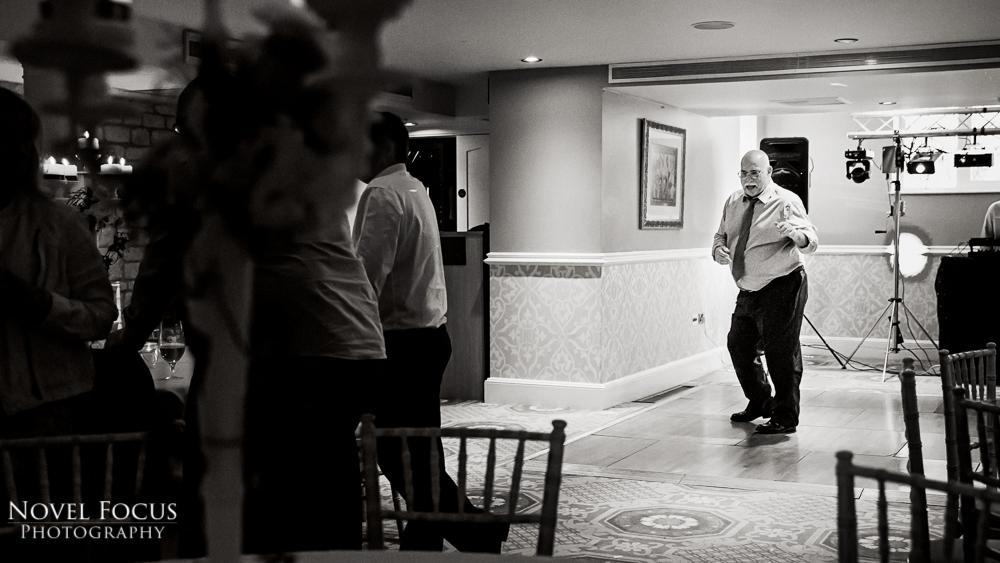 man dancing alone at wedding reception