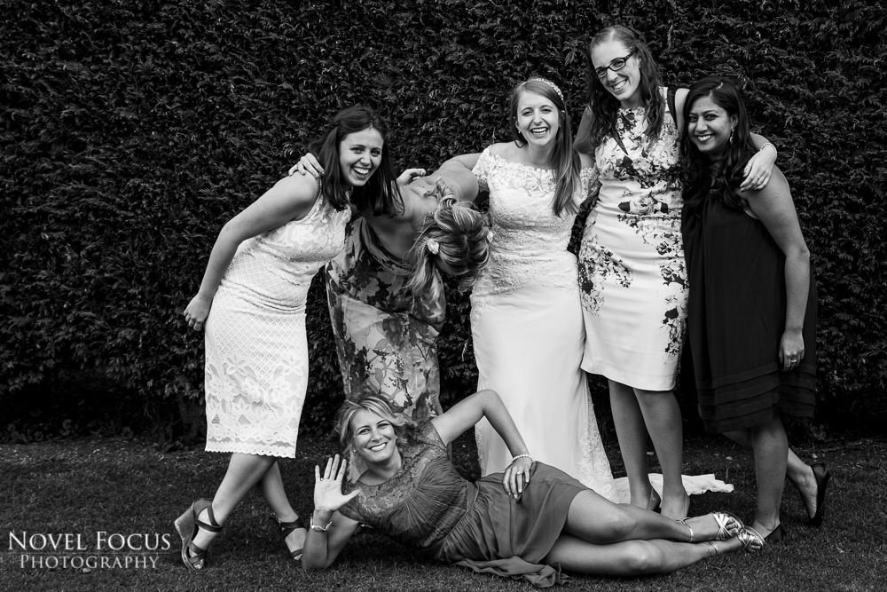 bride with friends at wedding reception laughing