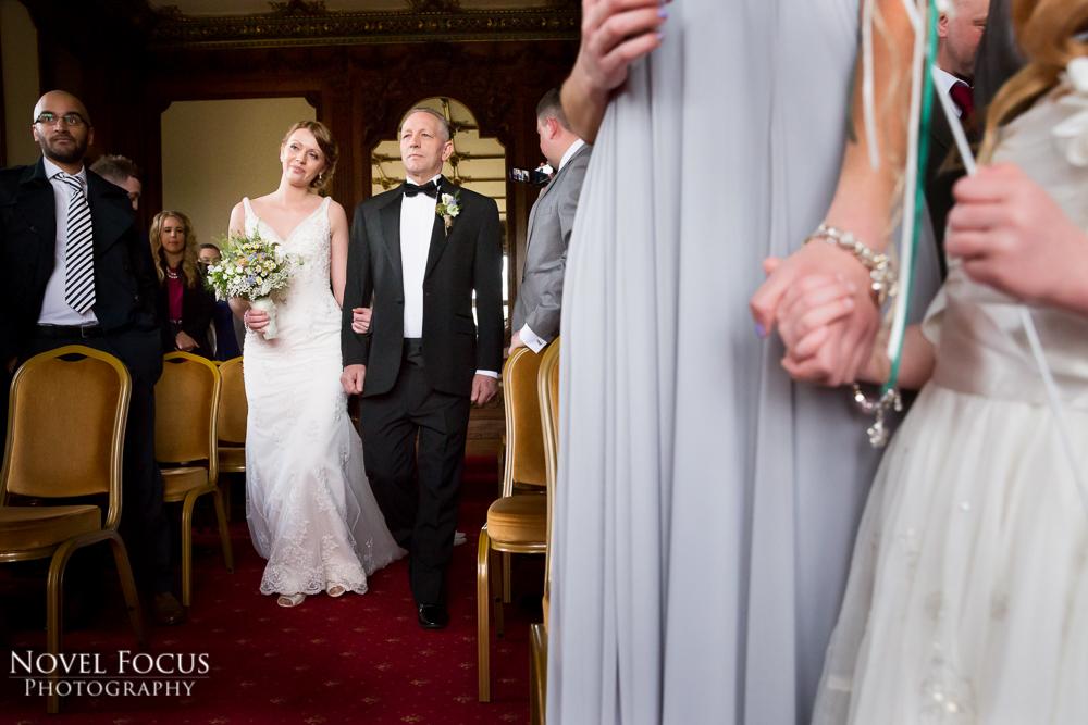 bride walking down aisle at manor by the lake cheltenham