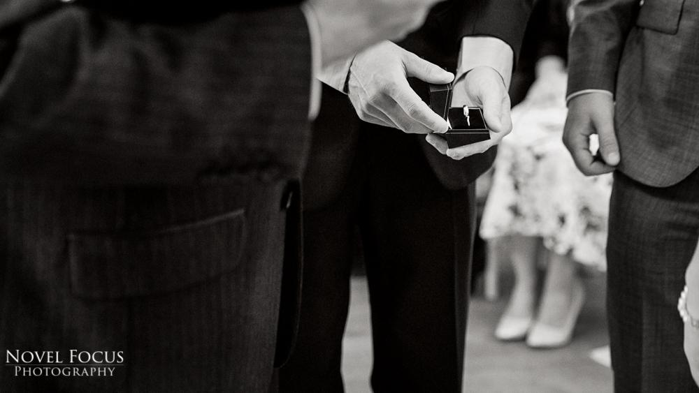 groomsman holding wedding ring