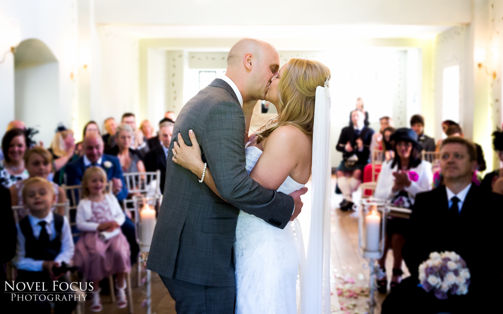 bride and groom kissing at ellenborough park cheltenham