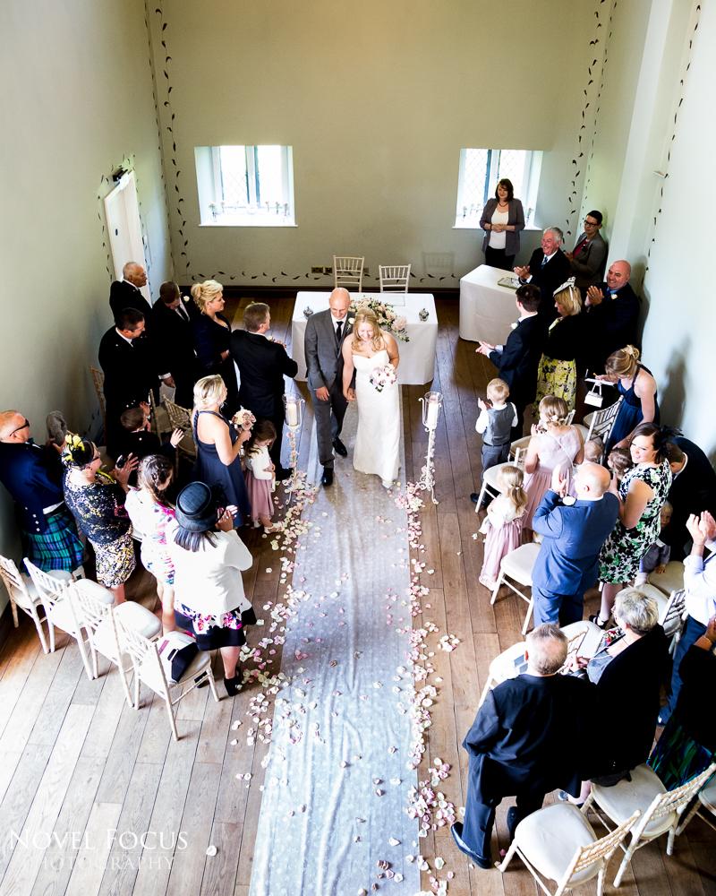 bride and groom leaving wedding ceremony at ellenborough park cheltenham