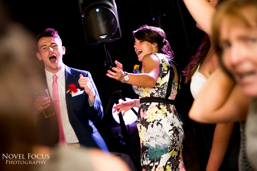 Reportage photograph of bridesmaid singing