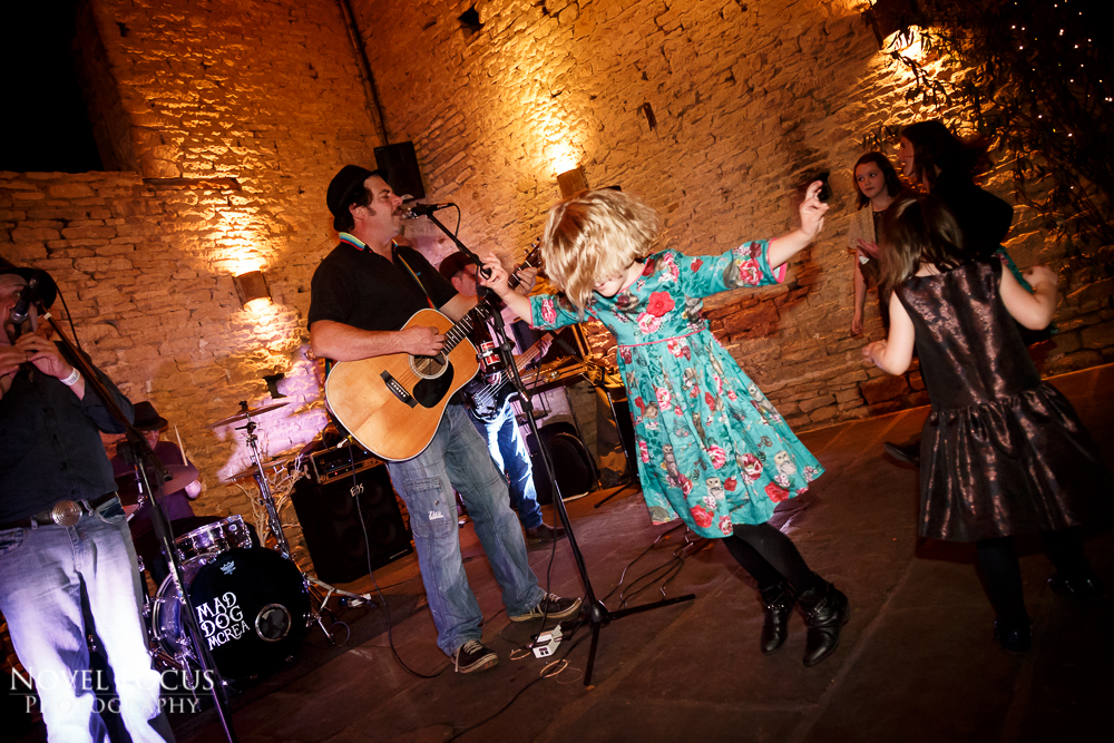 guests dancing at cripps barn wedding reception photography in bibury