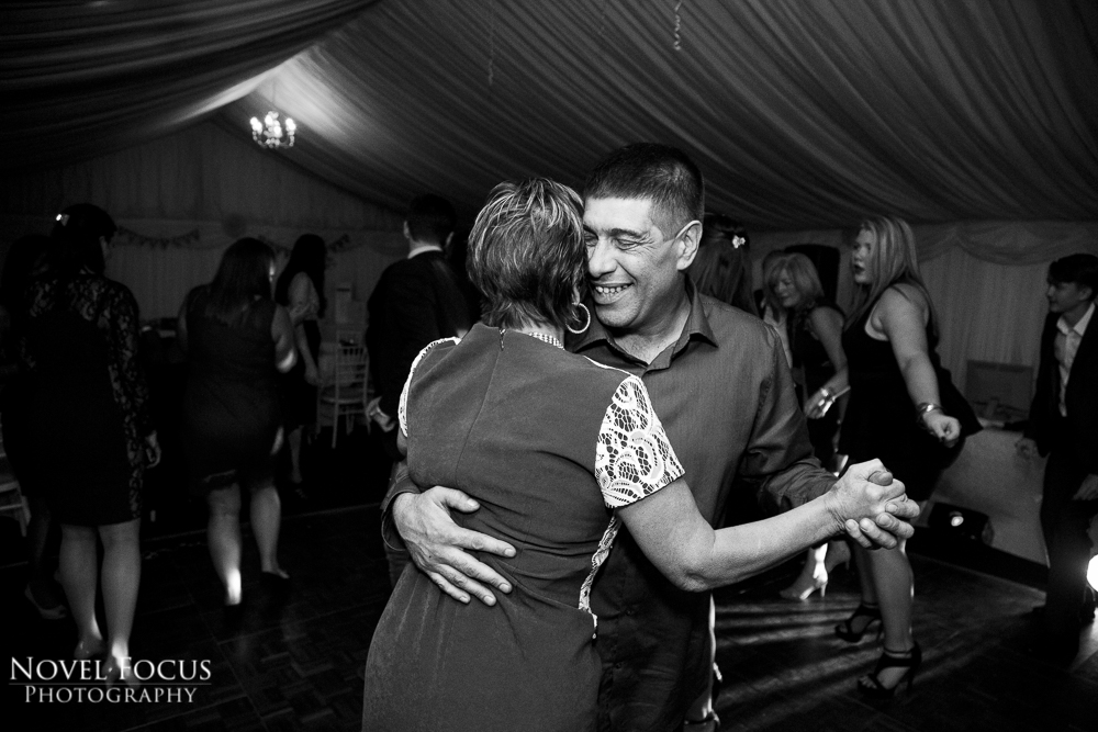 couple dancing at wedding reception in marquee