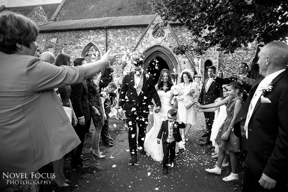 confetti outside church in black and white
