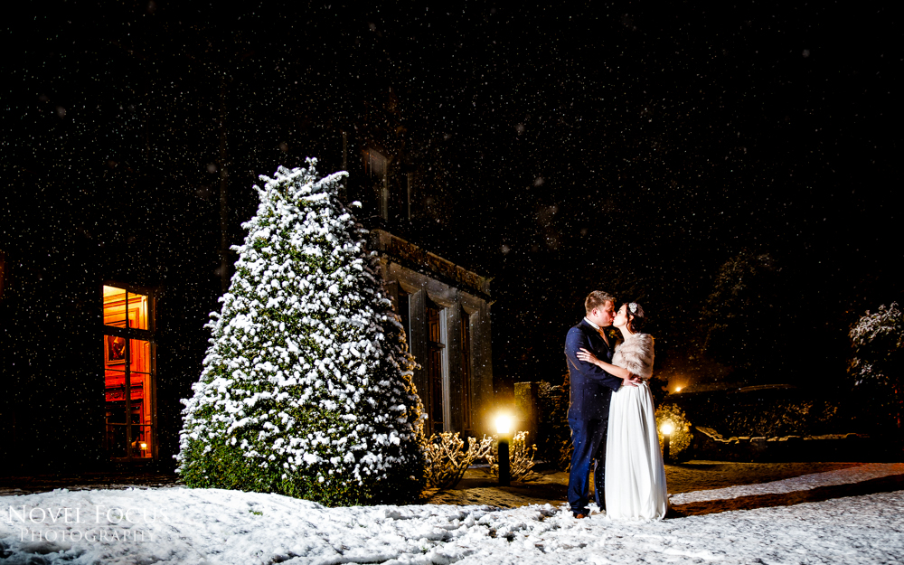 bride and groom in snow at wyck hill house