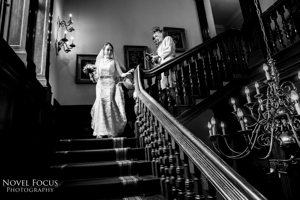 bride walking down stairs in gloucestershire