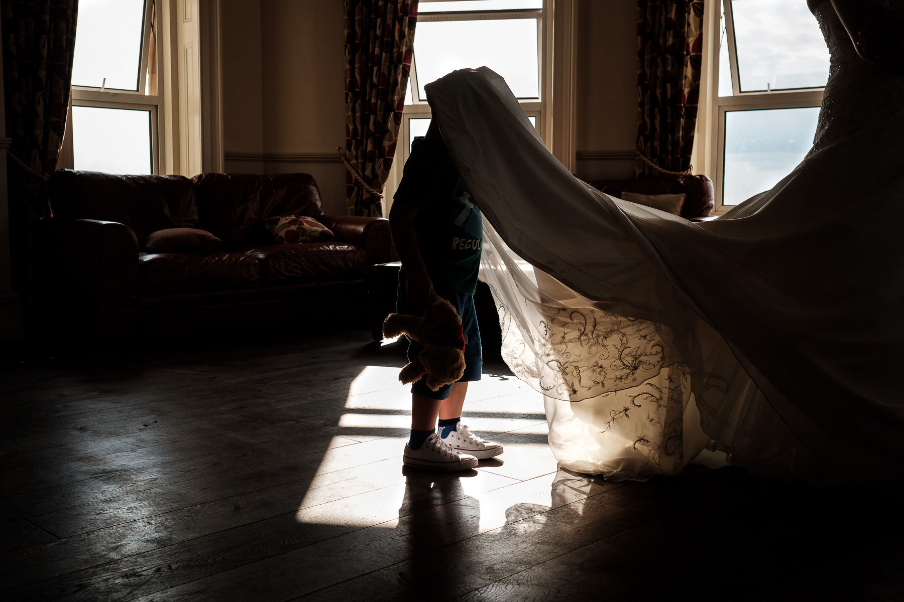 walton park clevedon boy with head under wedding dress