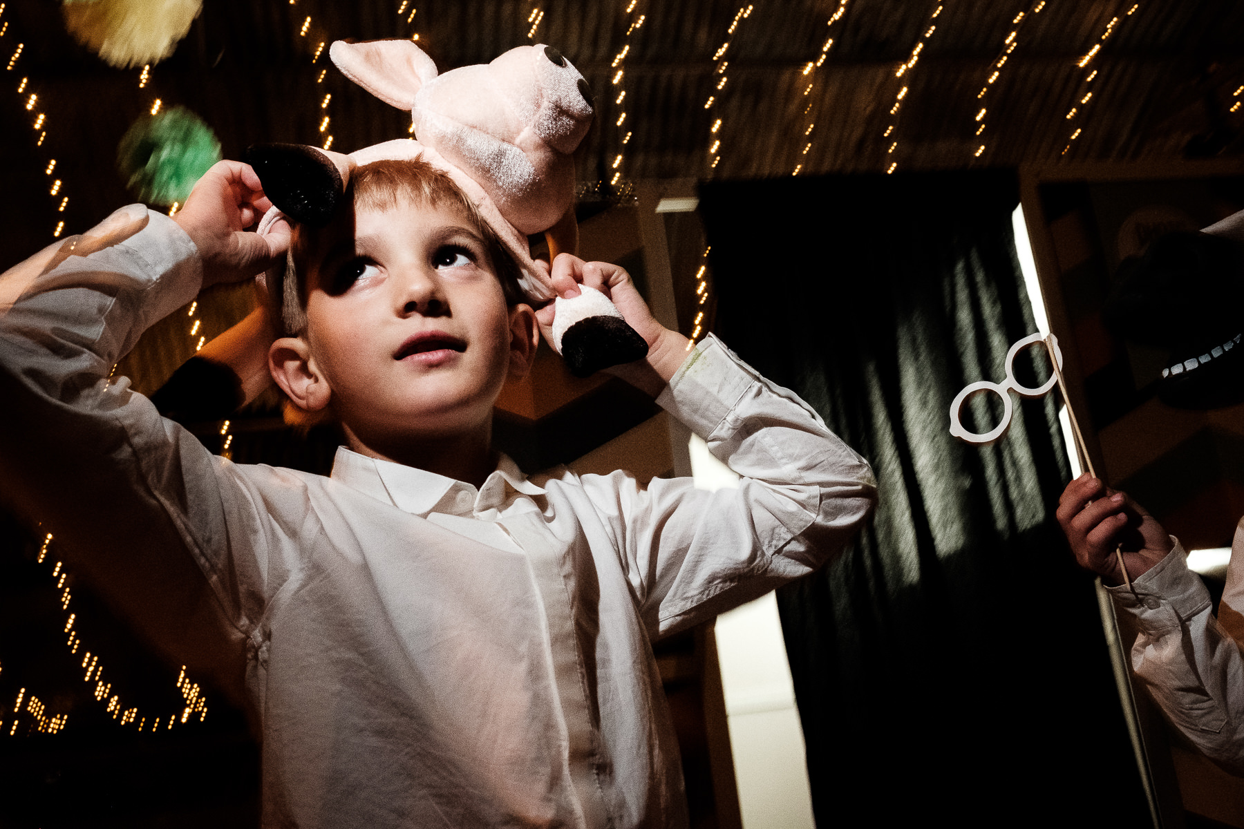 boy wearing mask at wedding reception