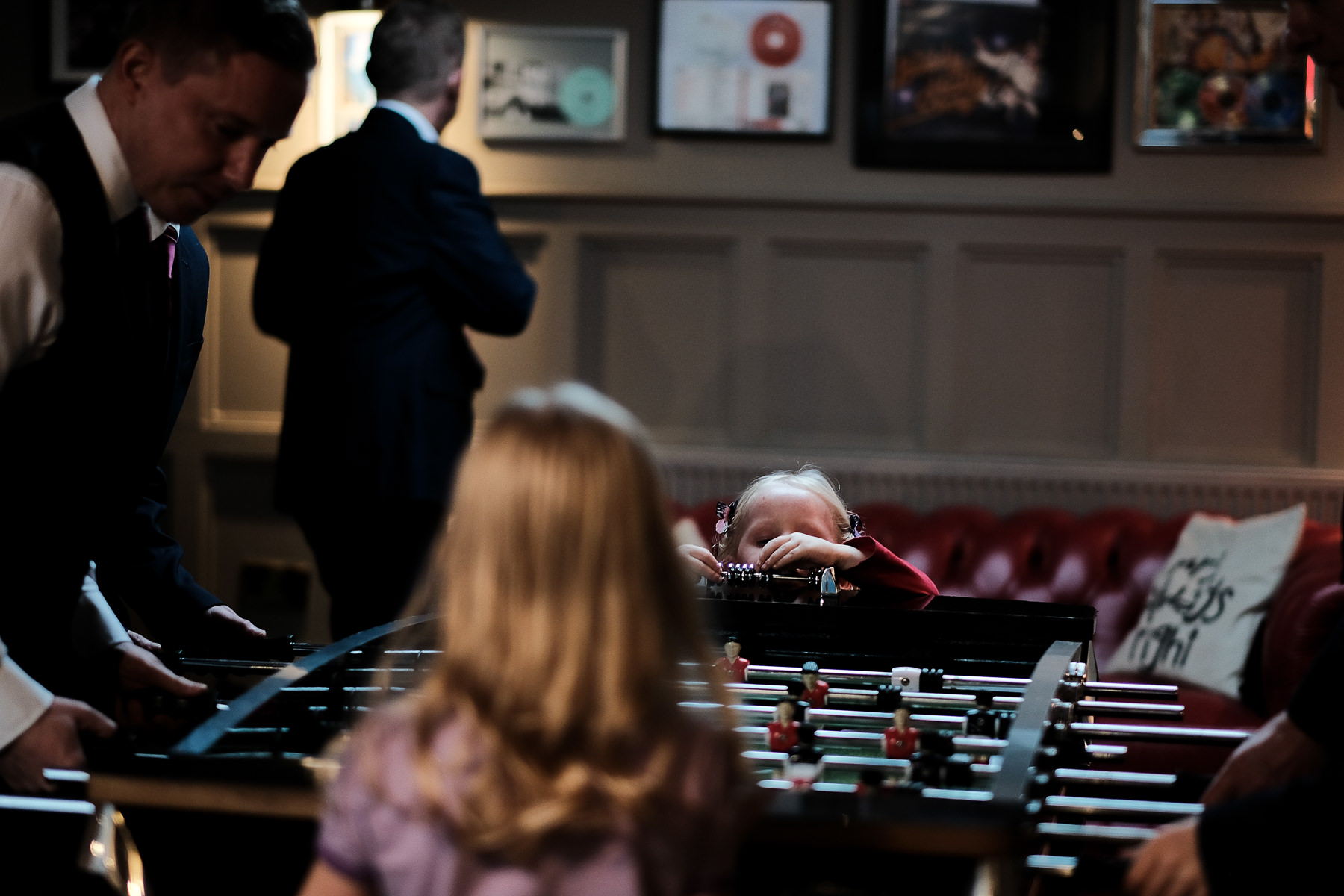 girl playing with foosball table