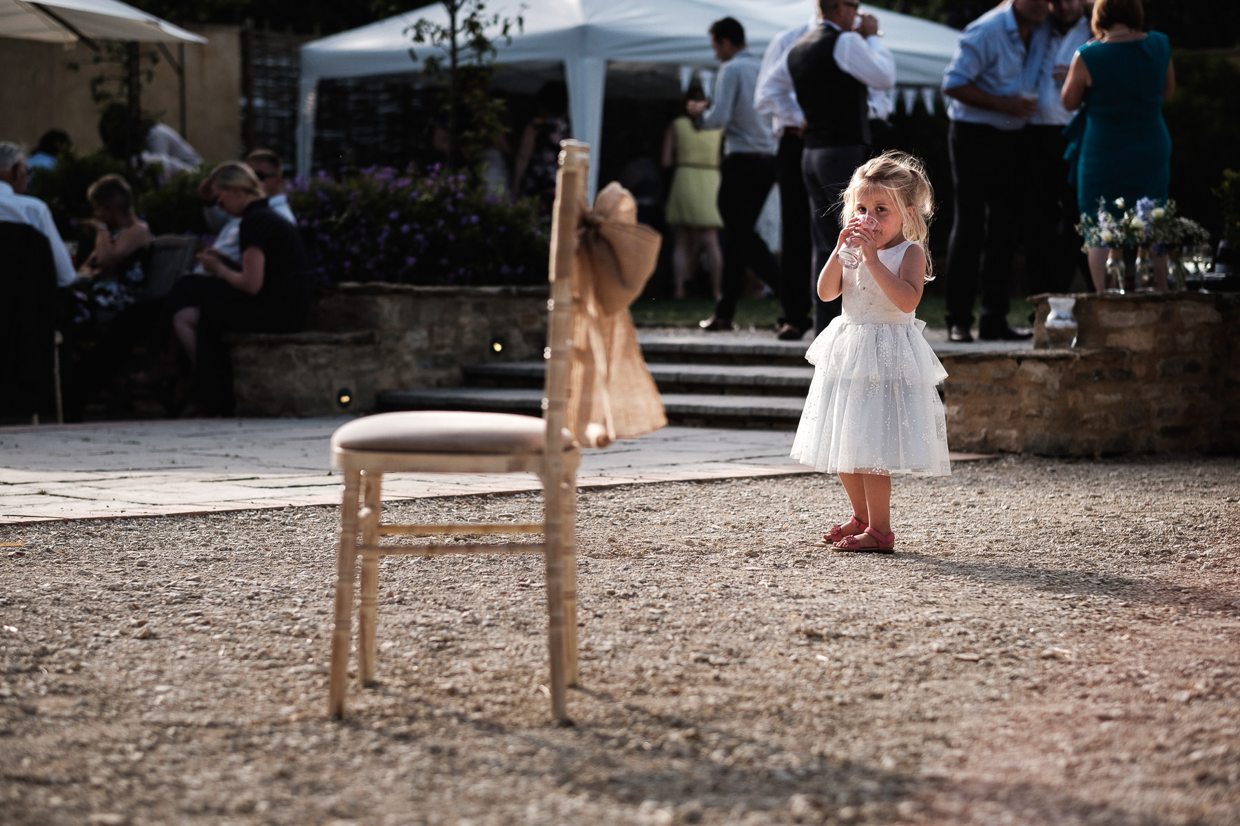 child looking at chair in burford