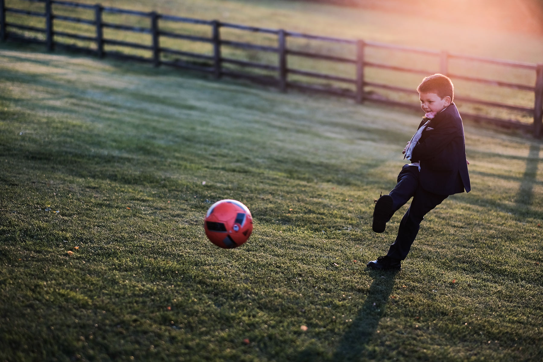 boy kicking ball wedding