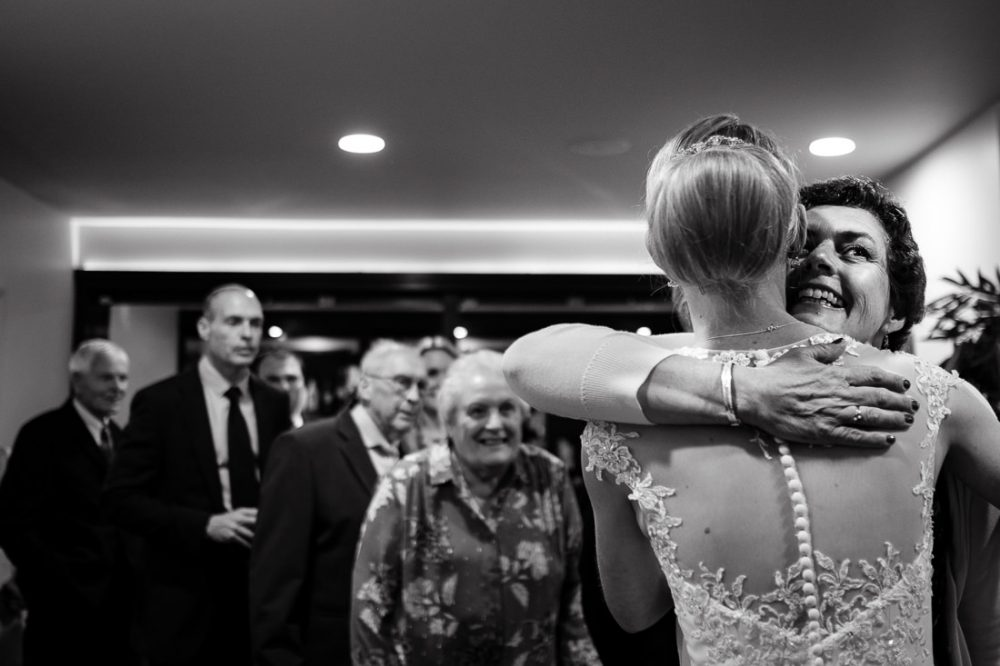 wedding guest hugging bride in bath