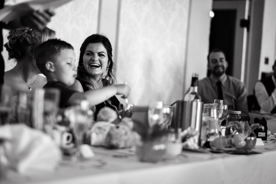 image from wedding reception guest laughing at speeches