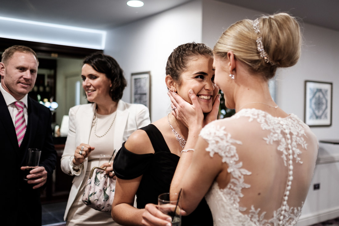 bride smiling with friend at wedding reception in bath