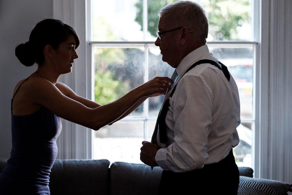 bride helping father do tie