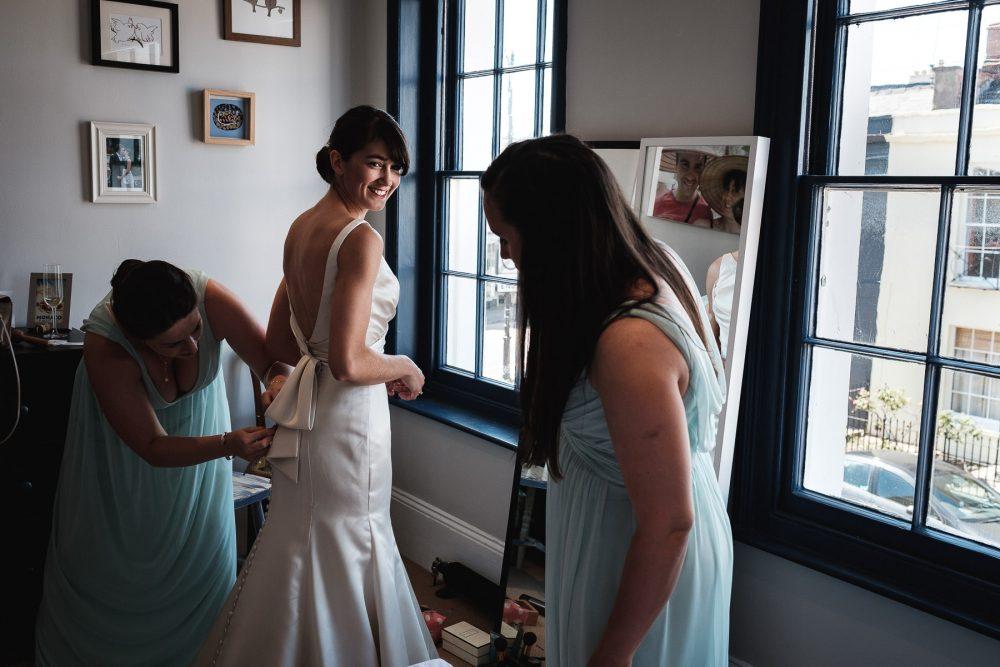 bride doing back of dress up