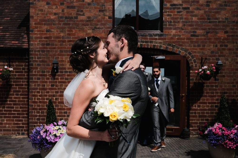 bride and groom smiling in redditch after wedding ceremony