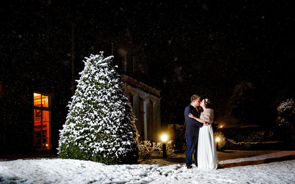 snow at wyck hill house wedding cold bride and groom