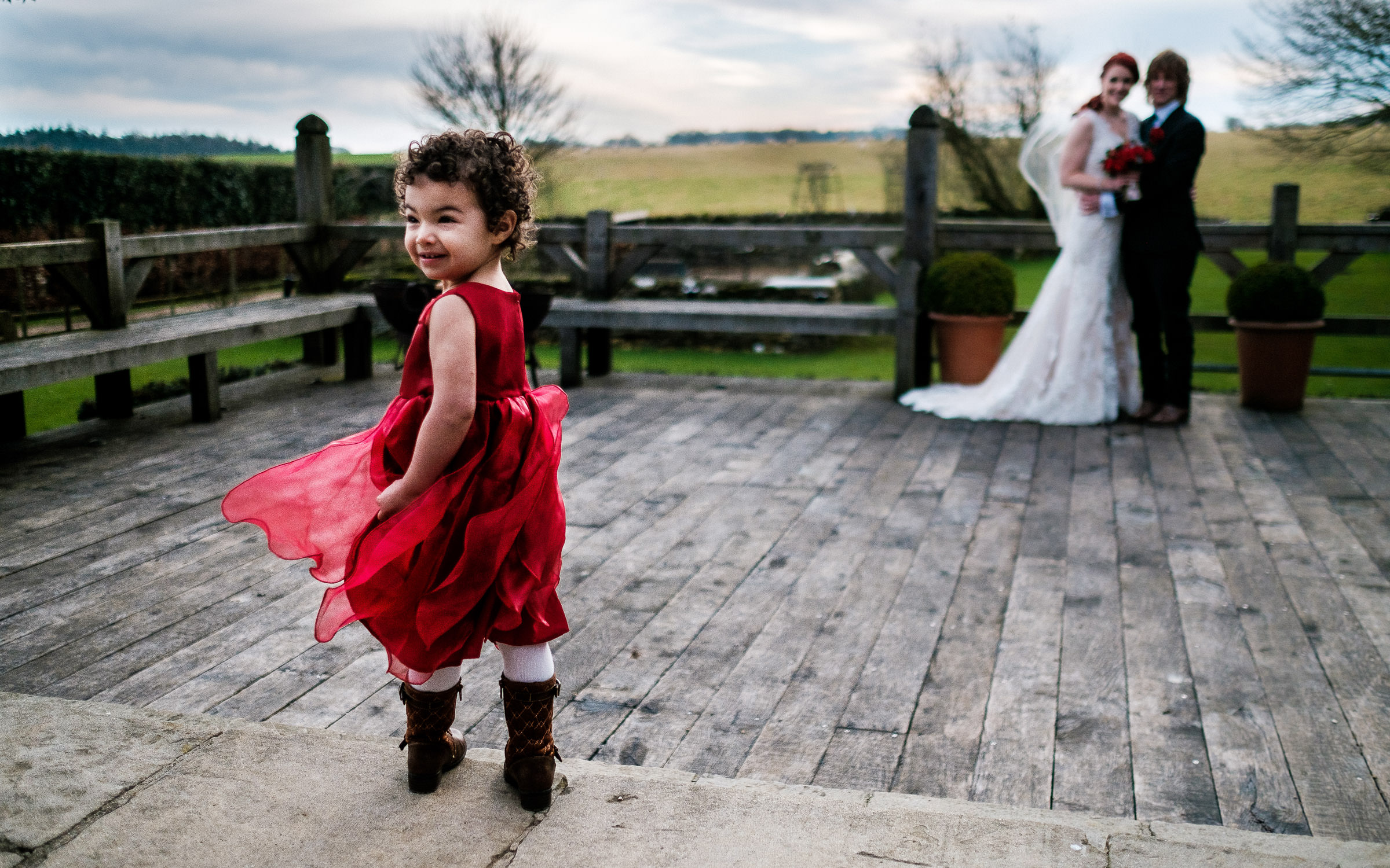 little girl with bride and groom