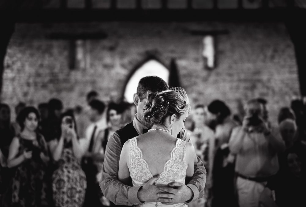 reportage wedding photograph of couple in first dance
