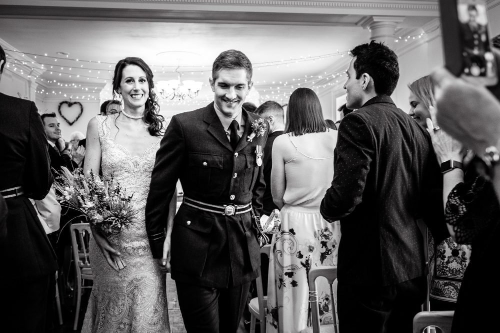 recessional documentary photograph of bride and groom