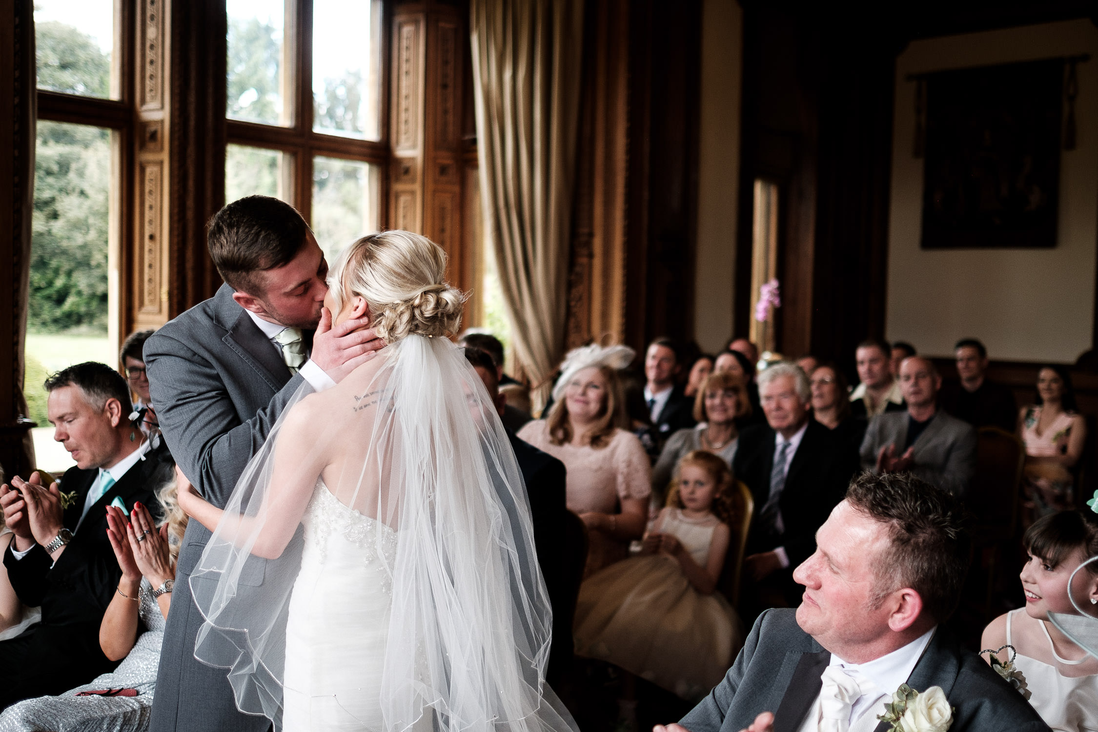 bride and groom kiss at end of ceremony