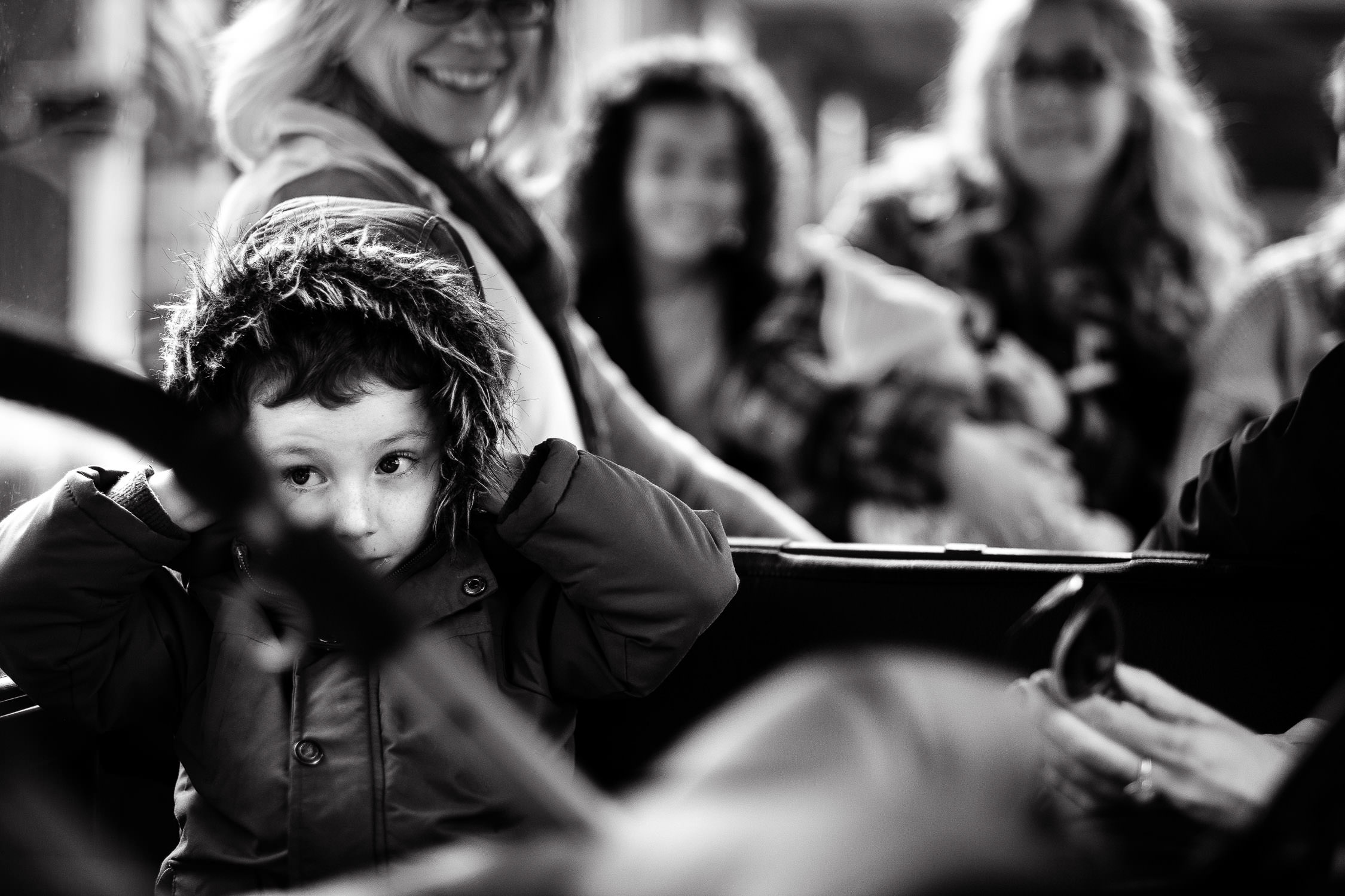 black and white picture of boy on train