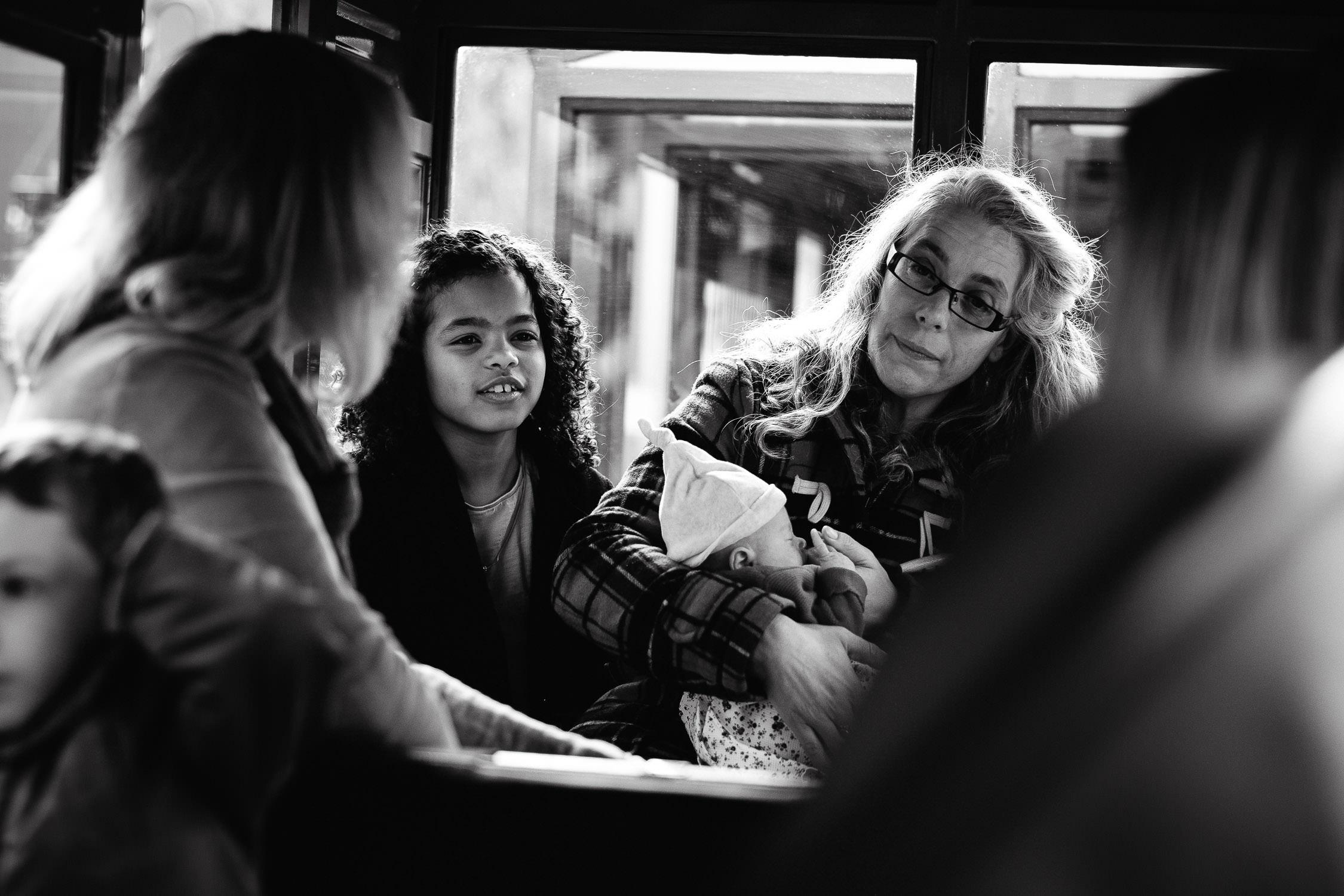 little girl sitting on train