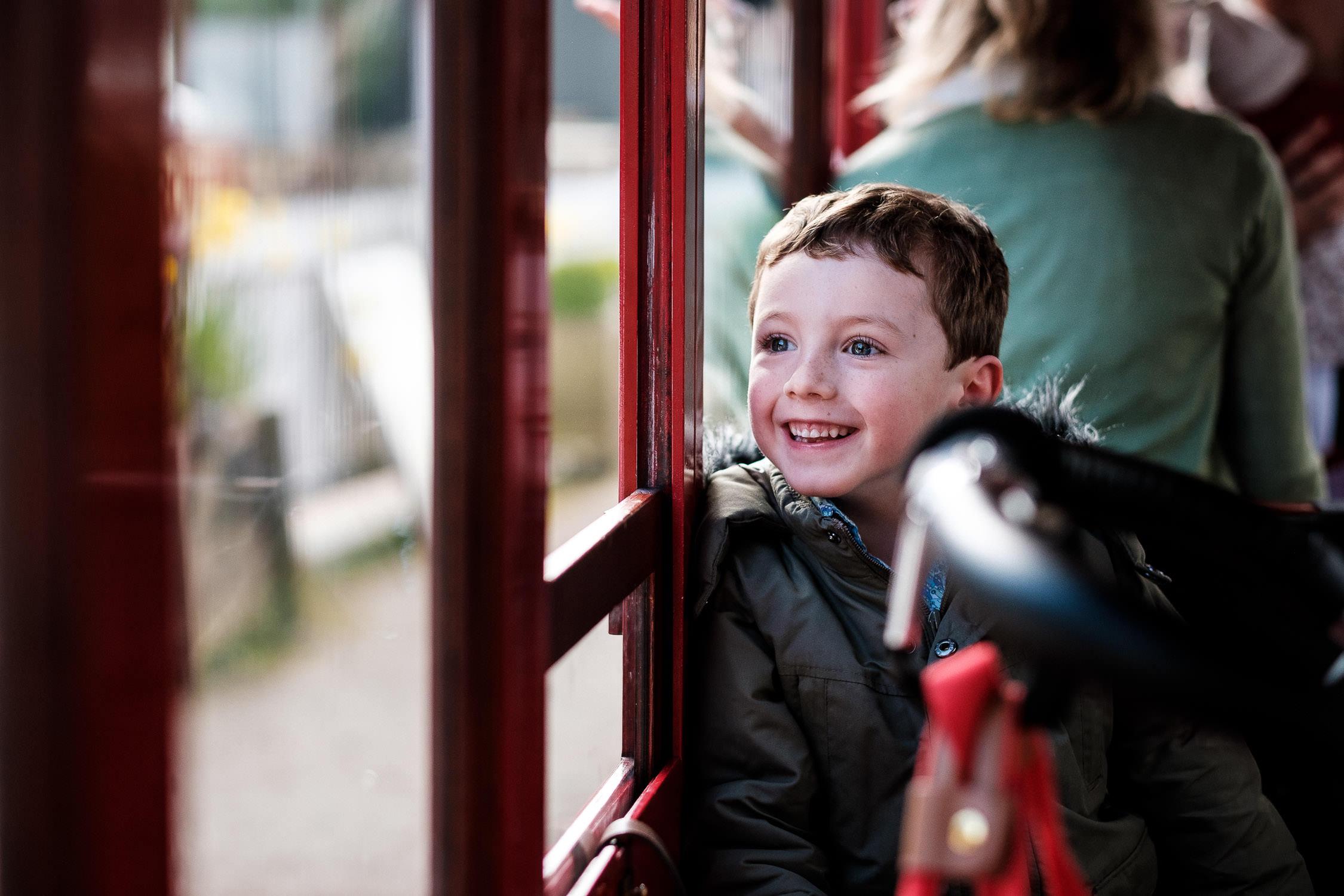 boy smiling through window